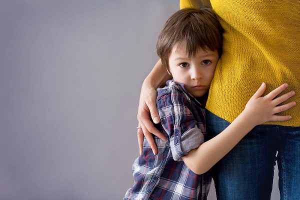 A child is having mental health issues and clings to his mom because he's tired.